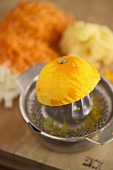 Half an orange on a citrus squeezer