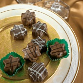 Star-shaped organic chocolates on a gold plate