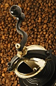 Coffee mill on coffee beans