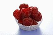 Raspberries in a paper case
