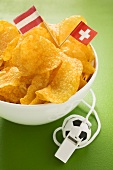 Crisps, flags of Austria and Switzerland and whistle
