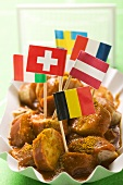 Currywurst (sausage with curry sauce) with European flags