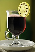 Mulled wine with clove-studded slice of lemon