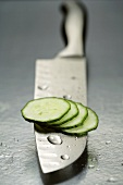 Cucumber slices on knife