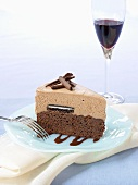 A piece of chocolate cake and a glass of red wine
