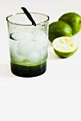 Mineral water with limes, ice cubes and vanilla pod
