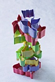 Coloured biscuits cutters, stacked