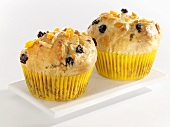 Two mango and marzipan muffins