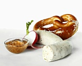 Weisswurst (white sausage) with pretzel and mild mustard