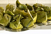 Bamboo and pork in banana leaf parcels