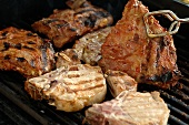 Various types of meat on barbecue