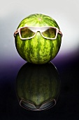 A watermelon wearing sunglasses