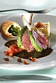 Lamb chops with pesto crust and tomato confit