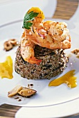 Grilled prawns, three grain couscous and orange sauce