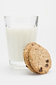 A glass of milk with two wholemeal biscuits