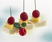 Cheese, pineapple and raspberries on cocktail sticks