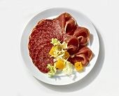 Cold cut plate (salami, raw ham) with sweet & sour pumpkin