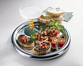 Crostini with tomatoes & olive paste & glass of sparkling wine