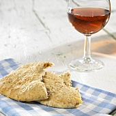 Pita bread and a glass of rosé wine