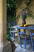 Table with ornamental gourds and flowers on terrace