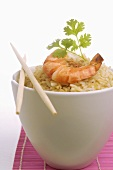 Bowl of rice with prawn and parsley