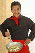 Asian chef with single-handled wok
