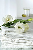 White towels with lisianthus flowers