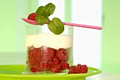Yoghurt with raspberries in a glass