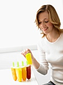 Woman with home-made fruit ice lollies