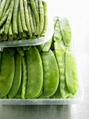 Green beans and mangetout in plastic trays