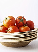 Tomatoes on a pile of plates
