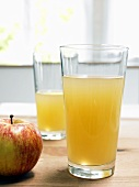 Glass of naturally cloudy apple juice