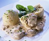 Bread dumplings with mushroom sauce