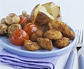 Chicken nuggets with tomatoes, mushrooms and baked potato