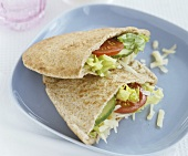 Wholemeal pita pockets filled with salad and grated cheese