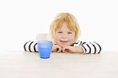 Little girl with beaker of water