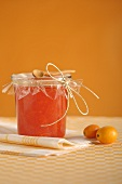 Orange and kumquat marmalade in jam jar