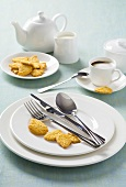 White place-setting with biscuits and coffee