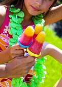 Children with ice lollies at a children's party