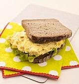 Scrambled egg sandwich on napkins