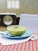 Cream of pea soup in a glass bowl
