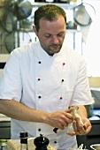 Chef peeling asparagus