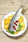 Stuffed pickled herring with beetroot and fried potatoes