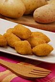 Potato croquettes and fresh potatoes