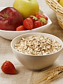Rolled oats, apples and strawberries