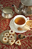 Tea with sugar crystals and biscuits
