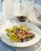 Butterflied salmon fillet with juniper berries and pepper