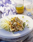 Chicken with mustard seeds and orange slices