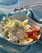 Stockfish puree with boiled eggs and tomatoes