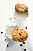 Two cranberry cookies and two cups of milk